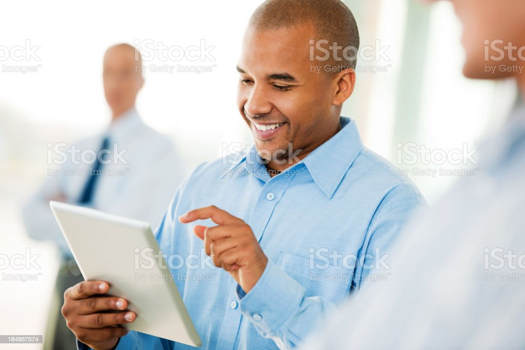 Smiling businessman with a digital tablet in hand royalty-free stock photo