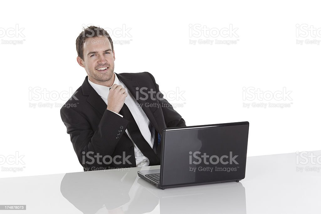Smiling businessman with a laptop royalty-free stock photo