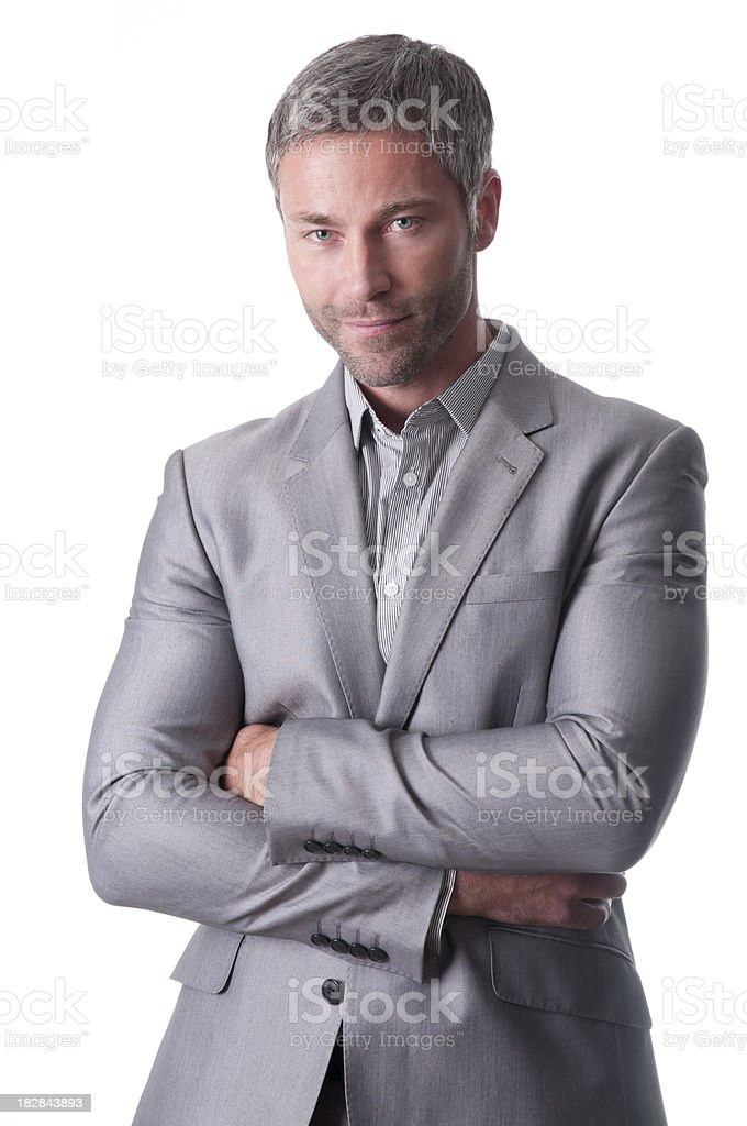 smiling businessman with arms crossed royalty-free stock photo