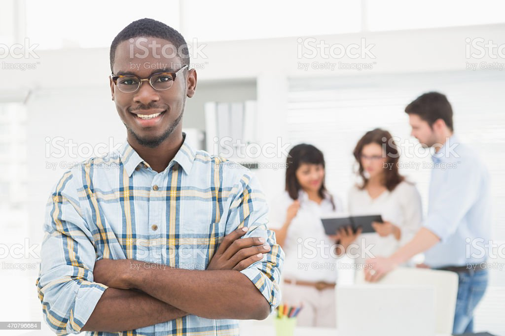 Smiling businessman with arms crossed stock photo