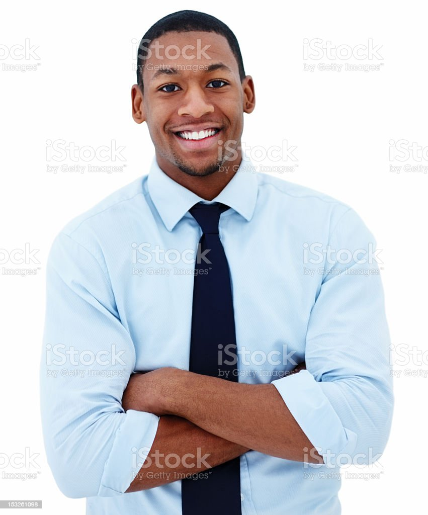 Smiling businessman with arms folded on white background stock photo
