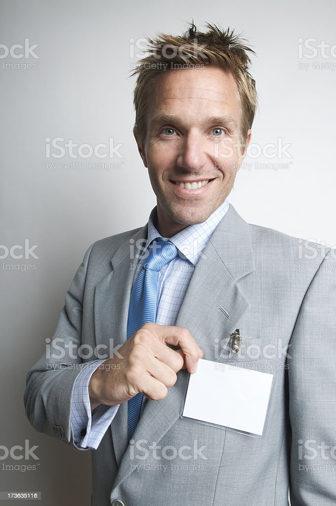Smiling Businessman with Blank Name Badge stock photo