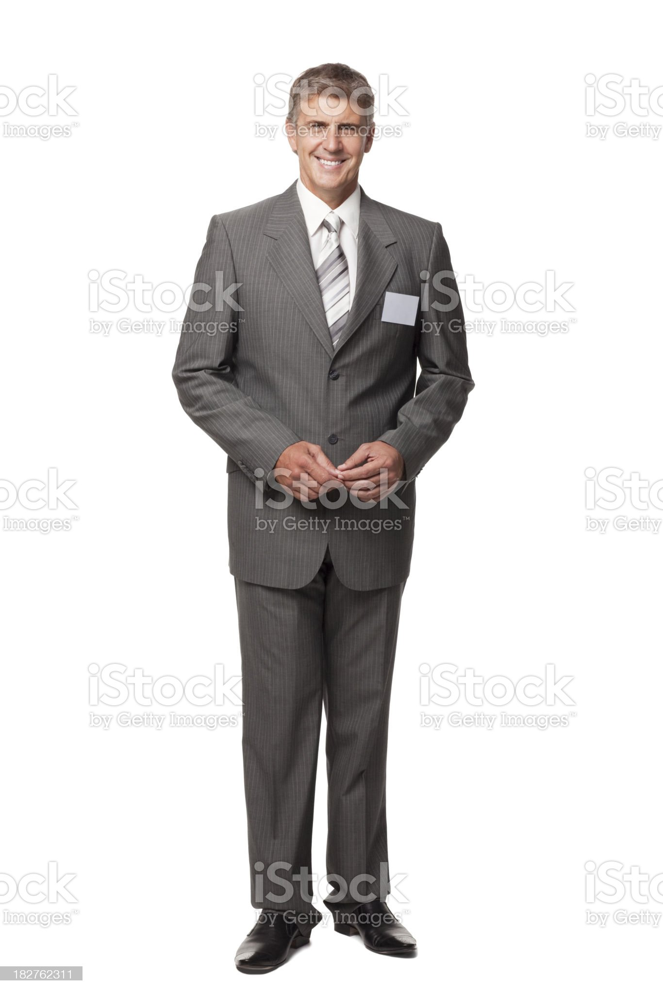 Smiling businessman with blank name tag royalty-free stock photo