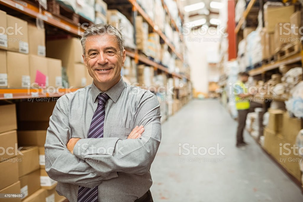Smiling businessman with crossed arms stock photo
