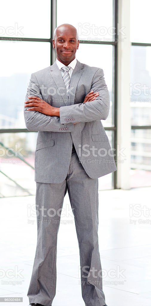 Smiling businessman with folded arms royalty-free stock photo