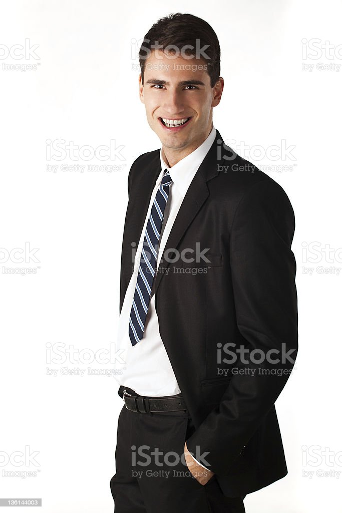 Smiling businessman with hands in pockets royalty-free stock photo