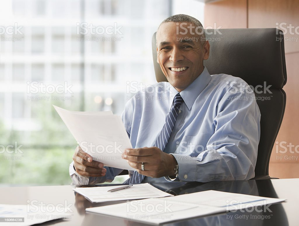 Smiling businessman with reports royalty-free stock photo