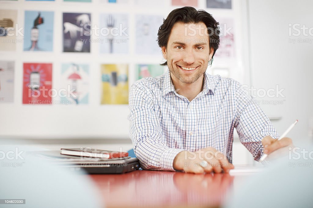 Smiling businessman working in office royalty-free stock photo
