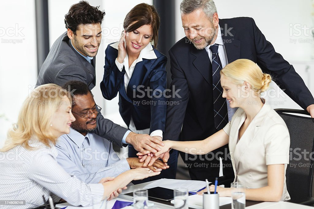 Smiling businesspeople celebrating success royalty-free stock photo