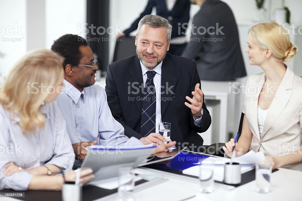 Smiling businesspeople discussing on a meeting royalty-free stock photo