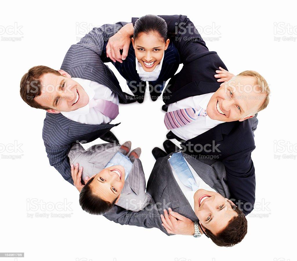 Smiling Businesspeople Huddled Together - Isolated royalty-free stock photo