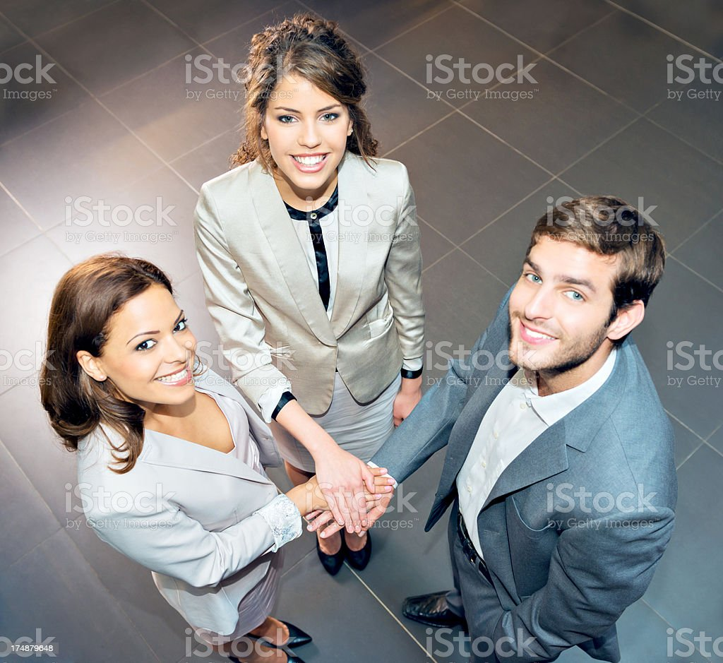 Smiling Businesspeople Huddled Together royalty-free stock photo