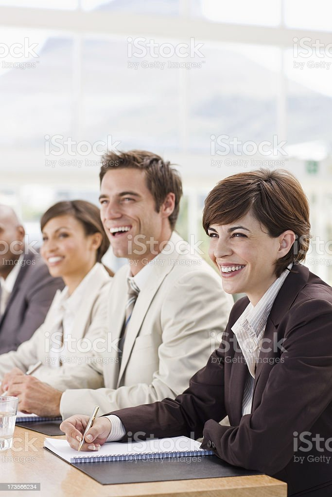 Smiling businesspeople in meeting royalty-free stock photo