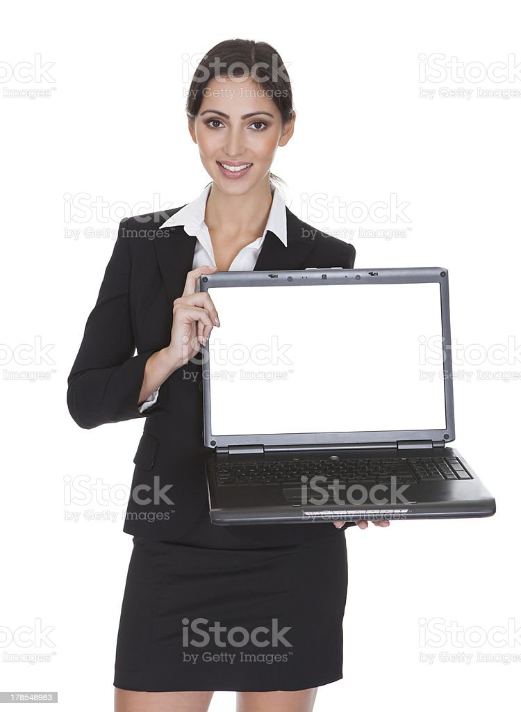 Smiling Businesswoman Holding Laptop royalty-free stock photo
