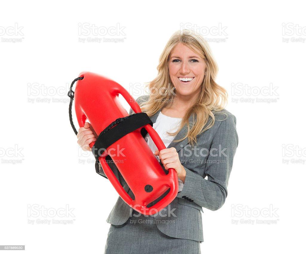 Smiling businesswoman holding life buoy stock photo