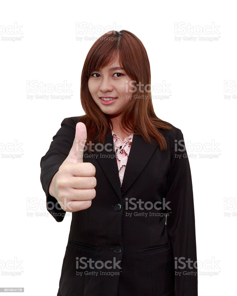 Smiling businesswoman holding thumps up on white background stock photo