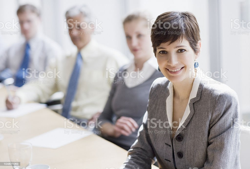 Smiling businesswoman in conference room stock photo