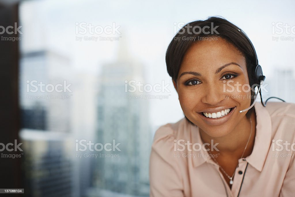 Smiling businesswoman in headset royalty-free stock photo