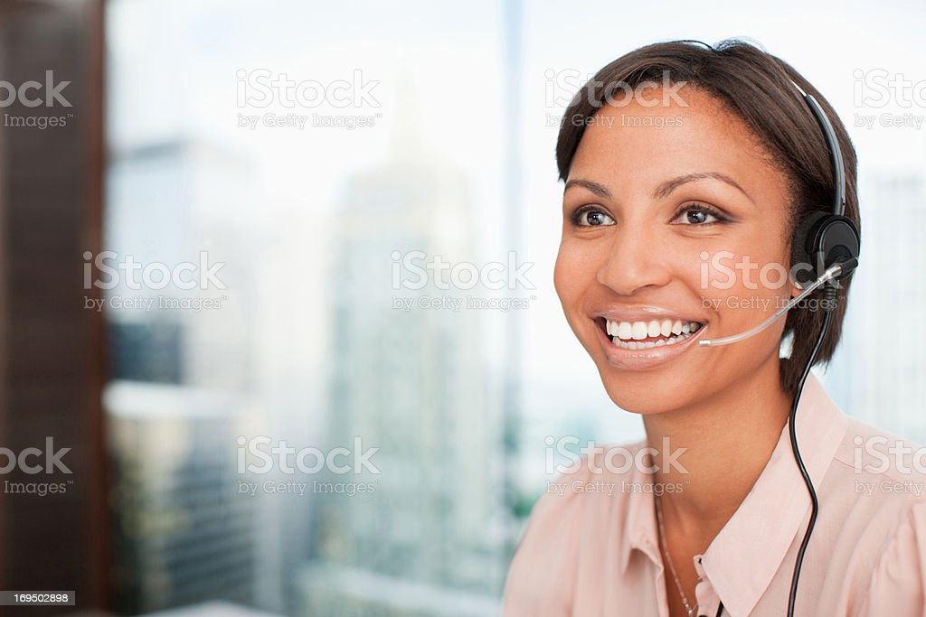 Smiling businesswoman in headset stock photo