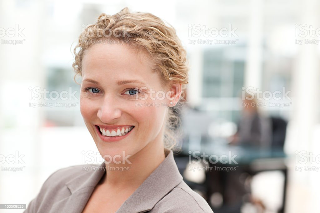 Smiling businesswoman in her office royalty-free stock photo