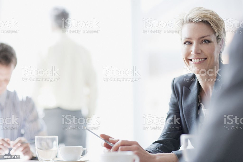 Smiling businesswoman in meeting royalty-free stock photo