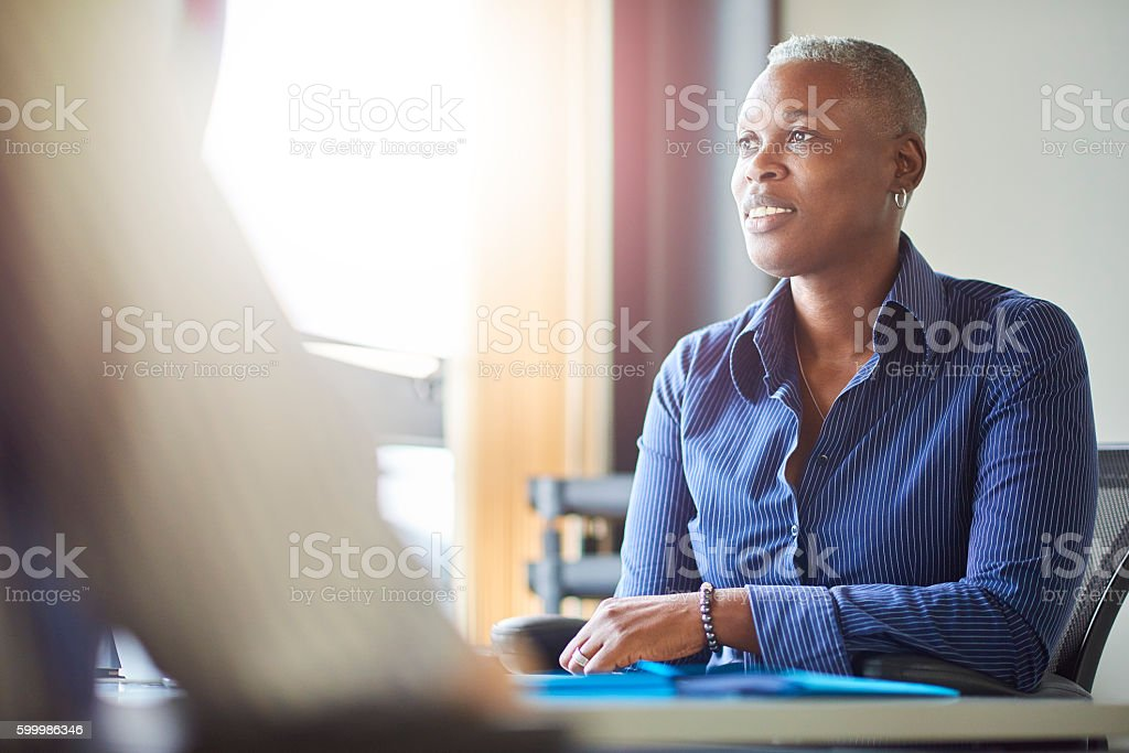 smiling businesswoman in meeting stock photo