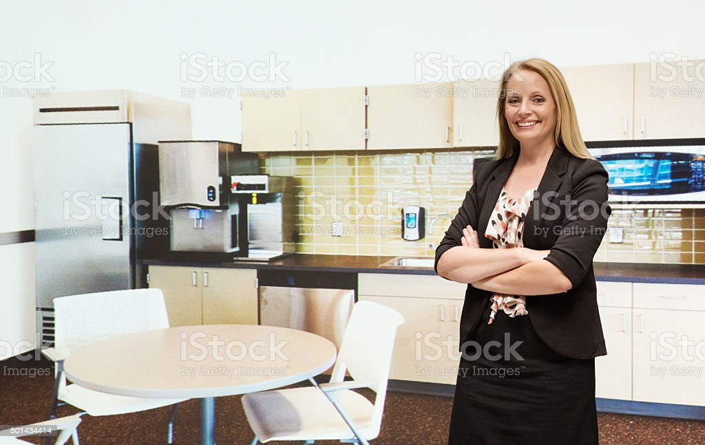 Smiling businesswoman in office stock photo