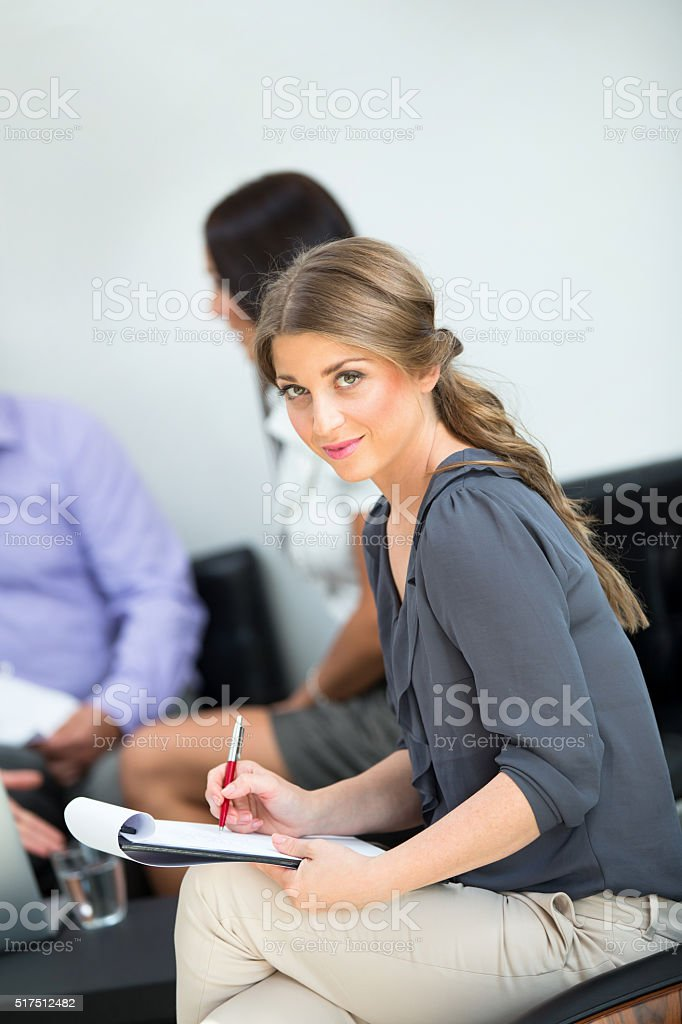 Smiling businesswoman in the office. stock photo