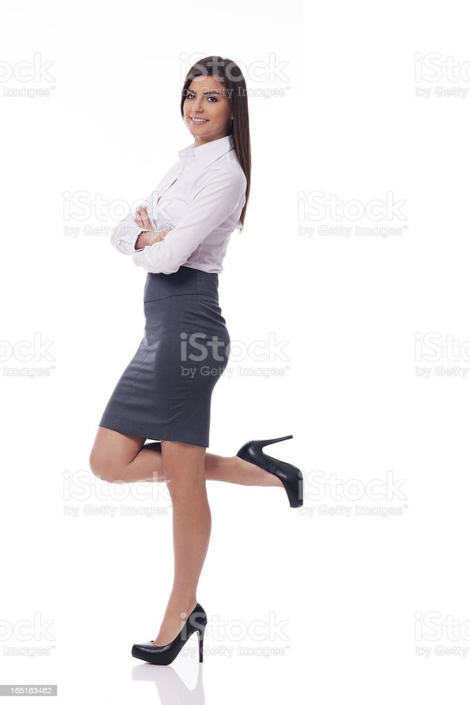 Smiling businesswoman leaning on something royalty-free stock photo