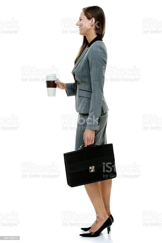 Smiling businesswoman looking away stock photo