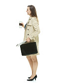 Smiling businesswoman looking away with coffee cup