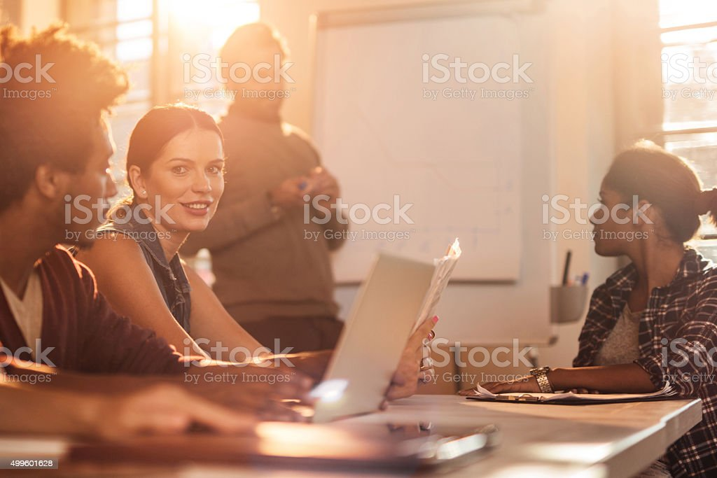 Smiling businesswoman on a business presentation in the office. stock photo