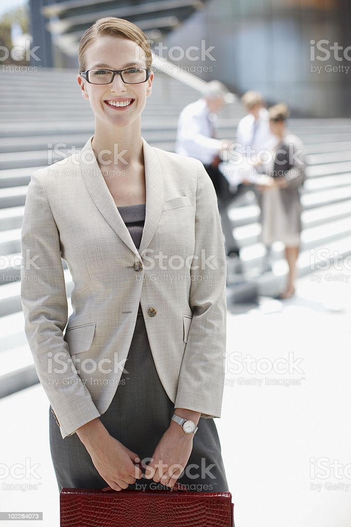 Smiling businesswoman outdoors royalty-free stock photo