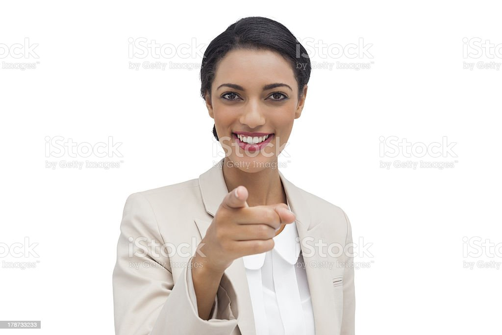 Smiling businesswoman pointing at camera stock photo