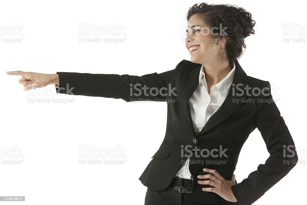 Smiling businesswoman pointing sideways royalty-free stock photo
