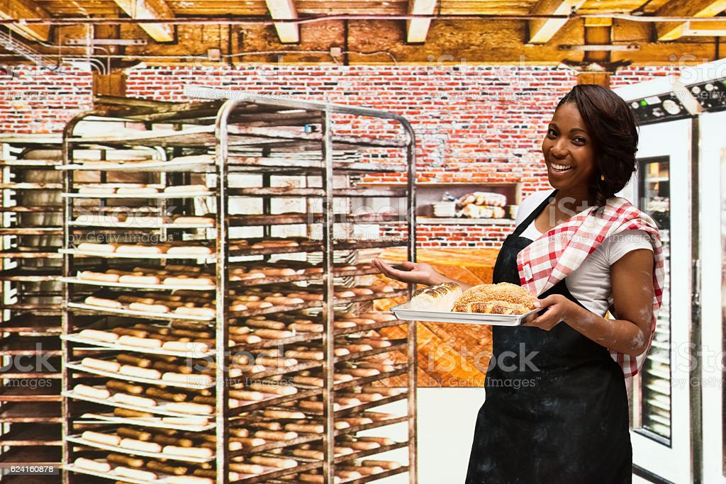 Smiling businesswoman presenting in bakery stock photo