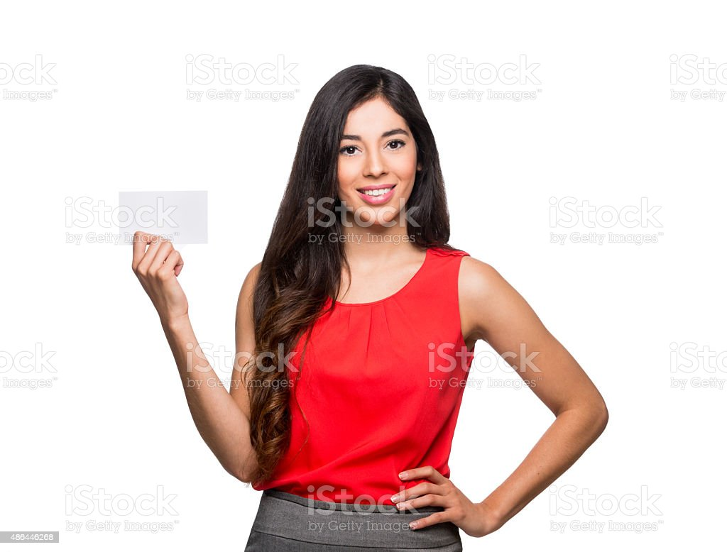 Smiling businesswoman showing business card stock photo