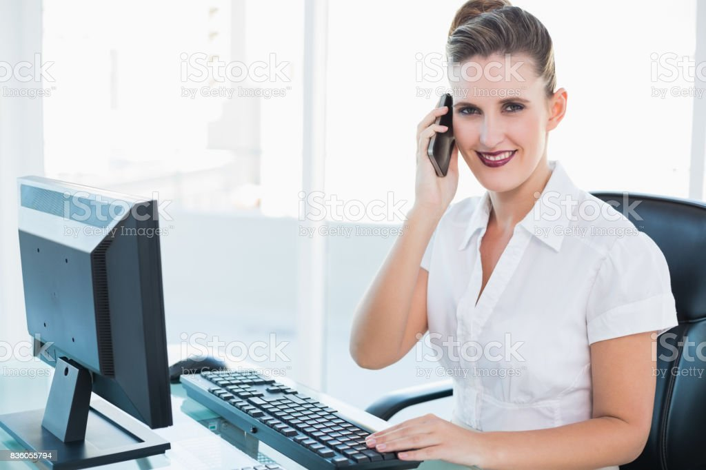 Smiling businesswoman talking on mobile phone stock photo