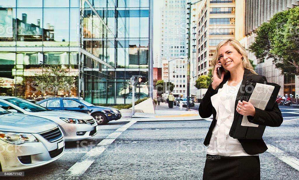 Smiling businesswoman talking on phone stock photo