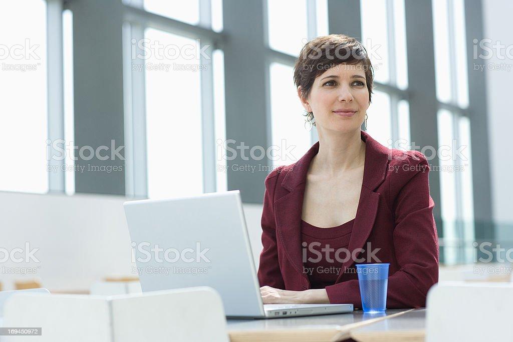 Smiling businesswoman using laptop royalty-free stock photo