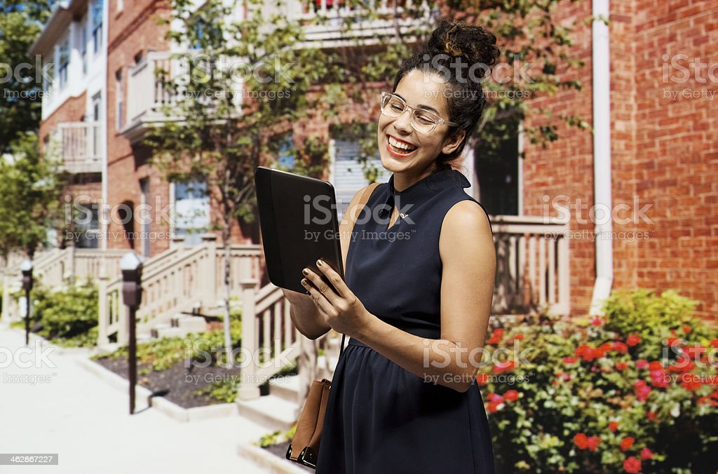 Smiling businesswoman using tablet on street royalty-free stock photo