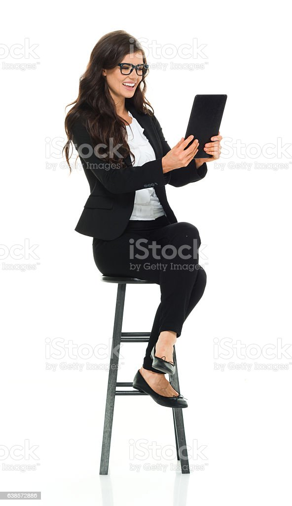 Smiling businesswoman using tablet stock photo