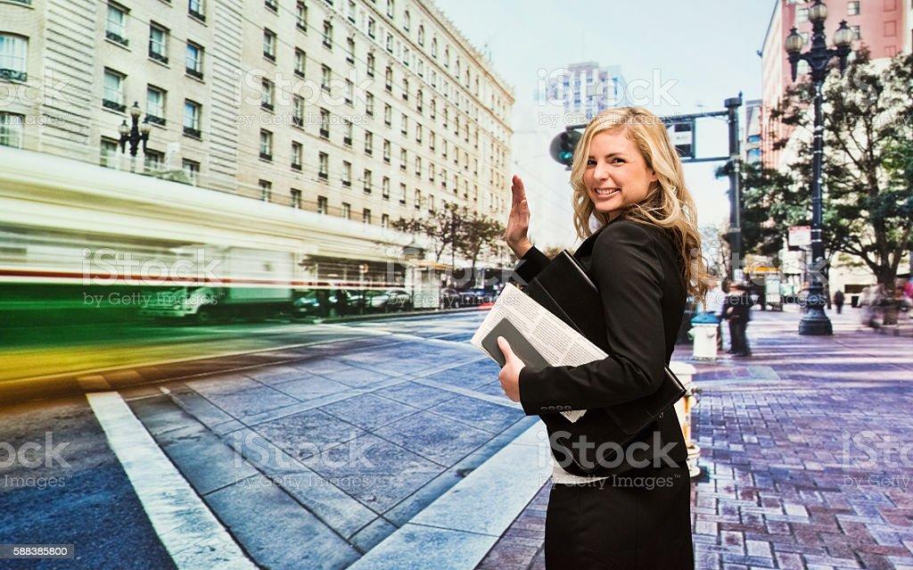 Smiling businesswoman waving hand stock photo