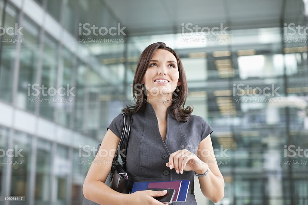 Smiling businesswoman with airplane ticket royalty-free stock photo