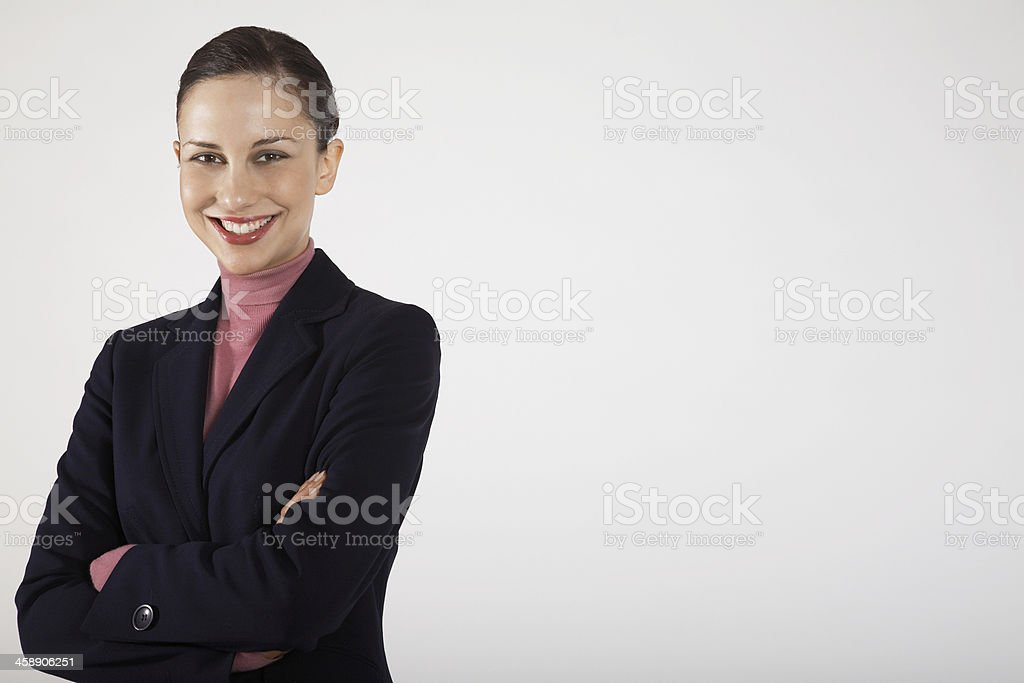 Smiling Businesswoman With Arms Crossed royalty-free stock photo