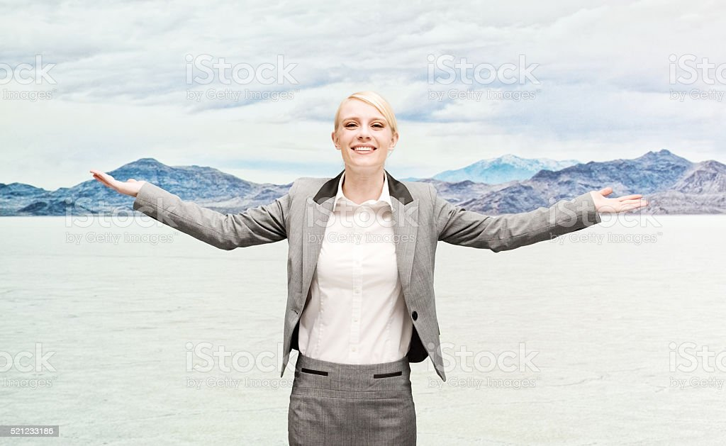Smiling businesswoman with arms outstretched stock photo