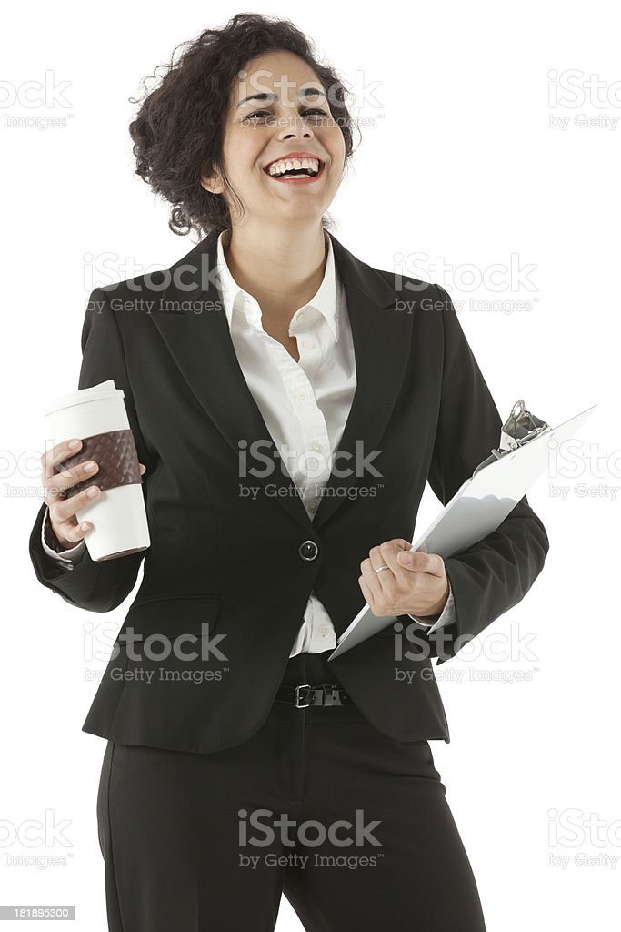 Smiling businesswoman with coffee and clipboard royalty-free stock photo