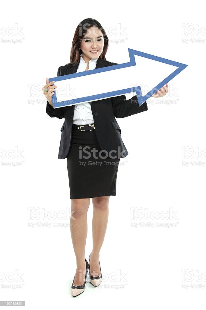 smiling businesswoman with direction arrow sign stock photo