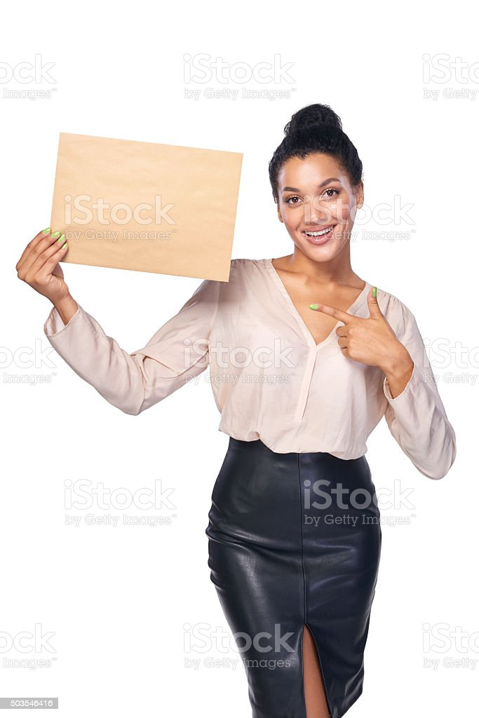 Smiling businesswoman with parcel stock photo