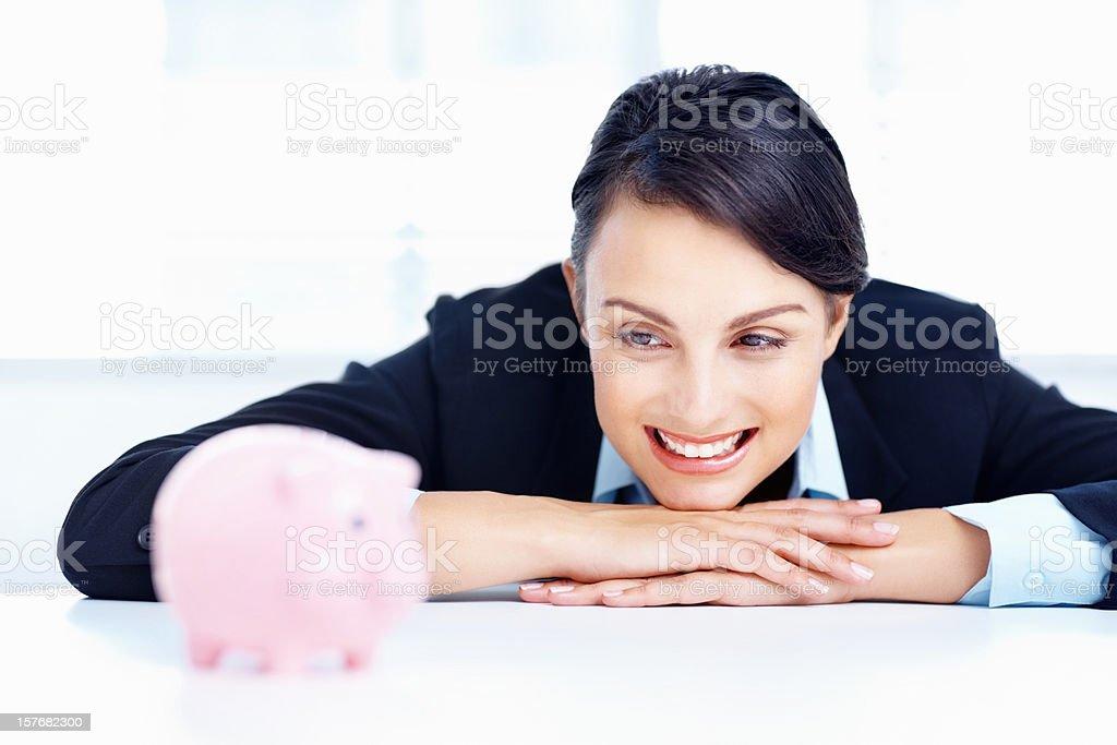 Smiling businesswoman with piggy bank stock photo